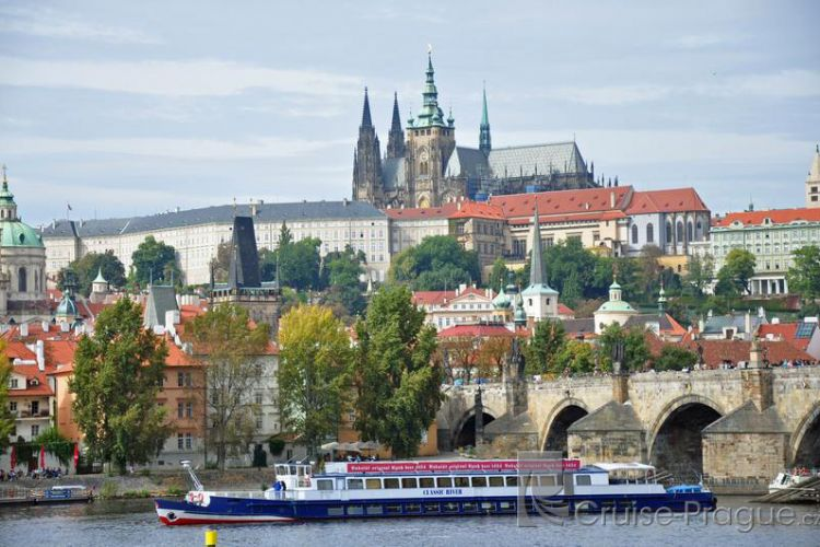 Prague Castle and the boat Classic River